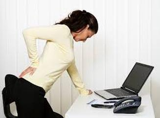 lady leaning over desk hold aching back