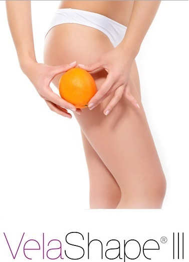 woman holding up orange to body