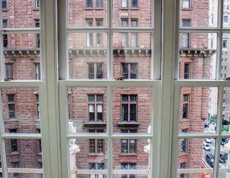 View of brick building through windowpanes.