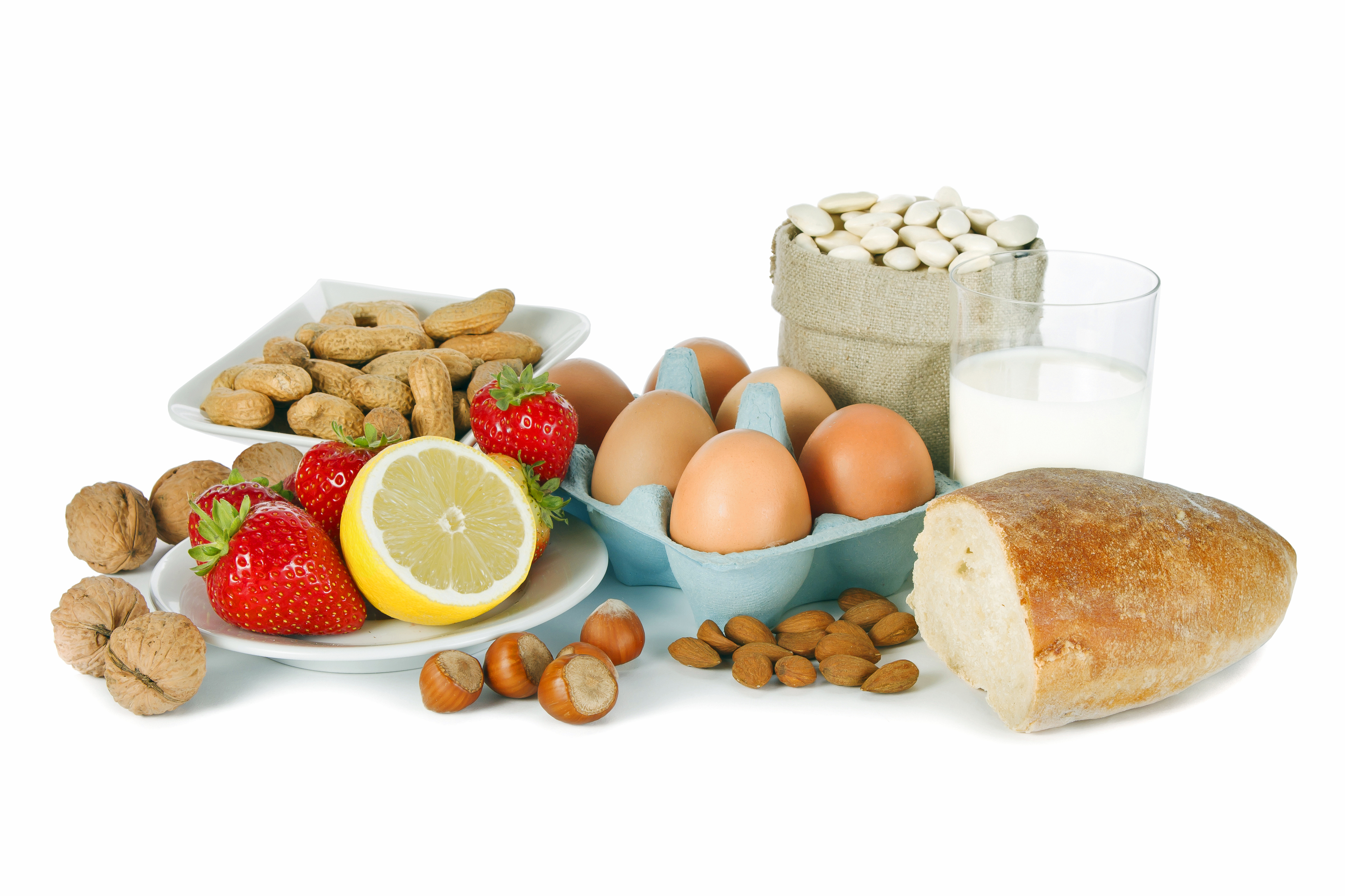 Picture of foods that cause allergies such as bread, strawberries, nuts, milk, eggs, and fruit.
